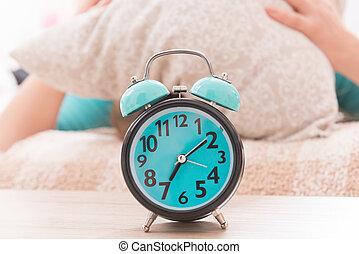 Alarm clock close to bed