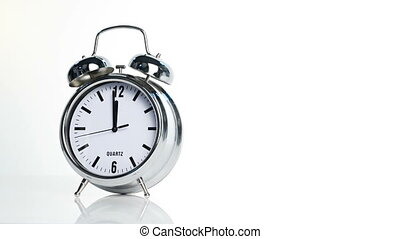 Alarm clock counting to twelve o'clock