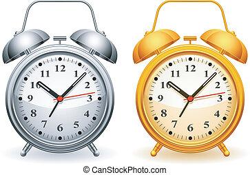 Alarm clock. - Metal and golden alarm clock.