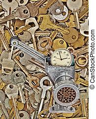 Alarm clock in meat grinder on old metal keys background.