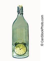 Alarm clock inside an old glass bot