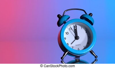 Alarm clock on a colored background. At 00:00 hours