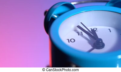 Alarm clock on a colored background. At 23:55 hours. Dolly ...