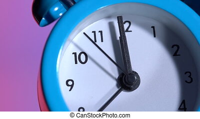 Alarm clock on a colored background. At 23:59 hours. Dolly ...
