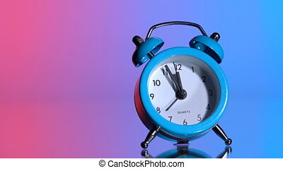 Alarm clock on a colored background - The alarm clock ...