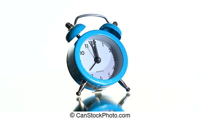 Alarm clock on a white background - The clock rotates on a ...