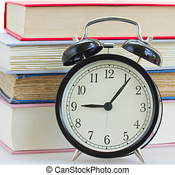 alarm clock on books background
