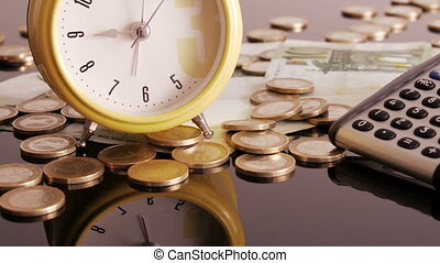 Alarm clock on coins and banknotes - Time is money. I offer...