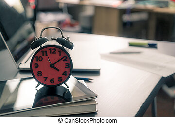 Alarm clock on office table with no people