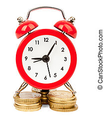 Alarm clock on stack of coins
