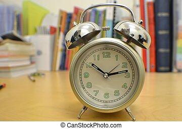 alarm clock on study desk