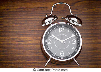Alarm Clock On Wooden Background