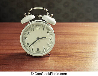 alarm clock on wooden.