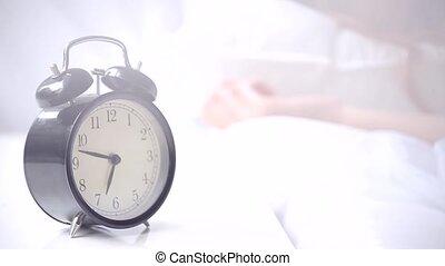 Alarm clock ringing at morning - Close-up of alarm clock...