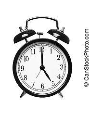 Alarm clock shows five o`clock