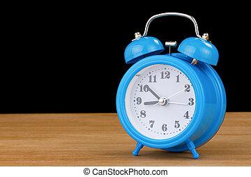 alarm clock watch on wood