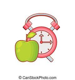 alarm clock with fresh apple fruit