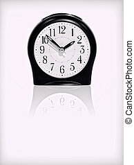 Alarm clock with reflection on white background.