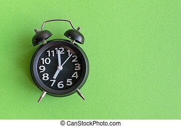Alarm clock with seven o'clock
