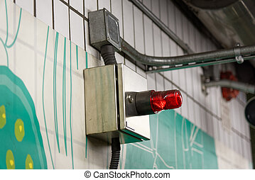 Alarm flasher on a wall