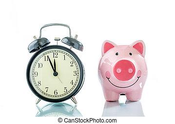 Alarmclock with piggybank on white background