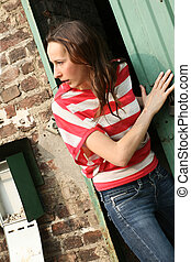 alarmed woman running away from a old house