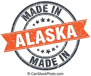 Alaska orange grunge ribbon stamp on white