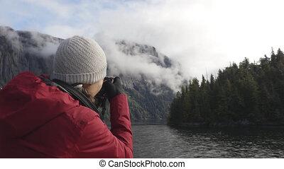 Alaska tourist photographer enjoying travel vacation cruise in Misty Fiords