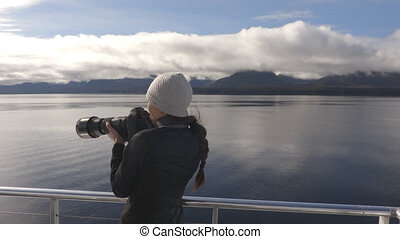 Alaska tourist wildlife photographer on travel vacation cruise in Misty Fiords