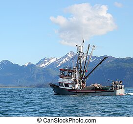 Classic Alaskan commercial fishing boat heading into the bay on a sunny summer day
