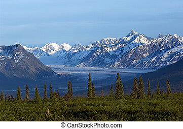 Glacier valley and mountain range in afternoon in Alaska