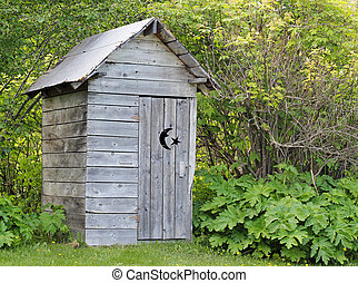 Alaskan outhouse in summer - Alaskan rustic wooden outhouse...