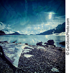 UFO over an Alaskan beach with a large ice shard processed with texture overlays for a surrealistic look.