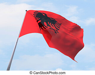 Albania flag flying on clear sky.