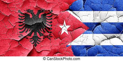 Albania flag with cuba flag on a grunge cracked wall