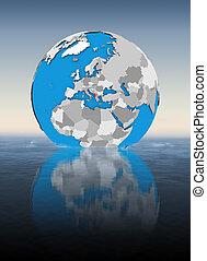 Albania on globe in water
