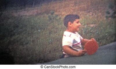 ALBANY, NY. USA - 1953: A child try table tennis - Original...