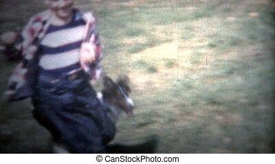 ALBANY, NY. USA - 1953: boy plays with dog - Original...