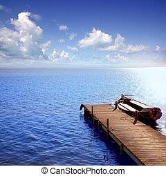 Albufera blue boats lake in El Saler Valencia