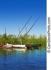 Albufera channel boats in el Palmar of Valencia Spain