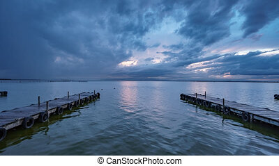 Albufera wooden pier with tourists timelapse at dusk - Wide...