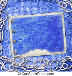 Album for photo with beads on the leafage ornamental background