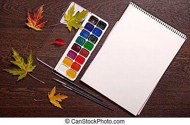album, watercolor, brushes and autumn leaves