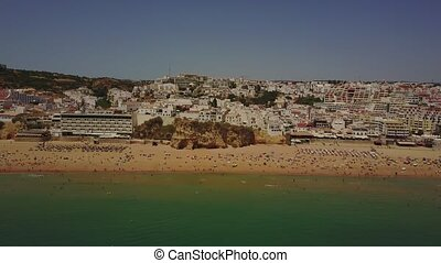 Albureira beach and architecture in coast of Algarve, Portugal