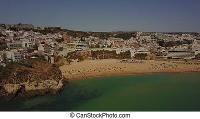 Albureira beach and architecture in coast of Algarve,...