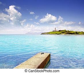 Alcanada Alcudia Mallorca with Aucanada island and lighthouse Balearic Spain