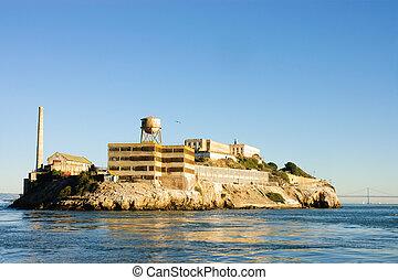 Alcatraz island in San Francisco Bay at sunset