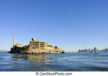 Alcatraz island in San Francisco Bay at sunset