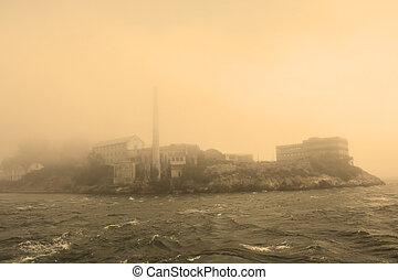 Alcatraz Island in San Francisco during the huge fog. Sepia toned