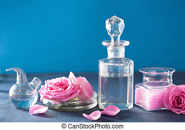 alchemy and aromatherapy with rose flowers and chemical flasks